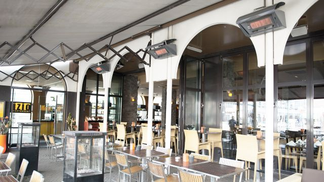 A restaurant terrace with infrared heaters by Schwank.